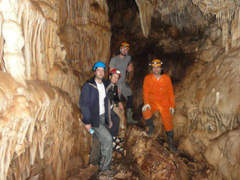 Researchers in a cave