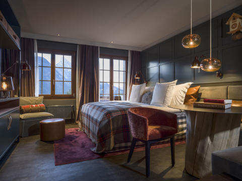 Guest room at HUUS Hotel, Gstaad, Switzerland, designed by Stylt Trampoli