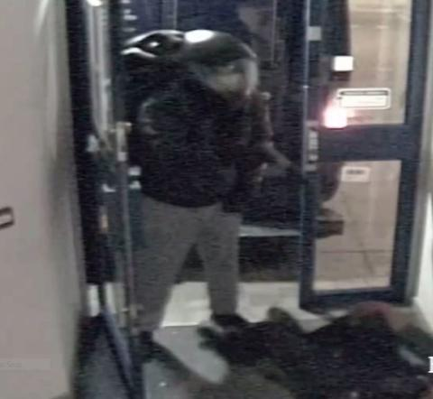 CCTV still of armed robber
