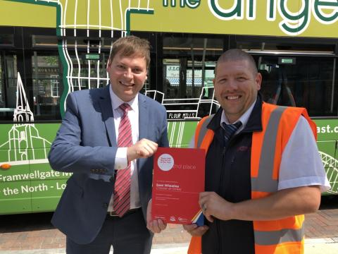 Sean Wheatley presented with his Team GNE Bus Driver of the Year runner-up certificate