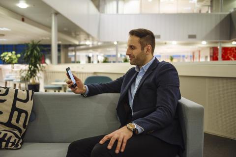 Sony_Nimway_Man_Looking_at_Phone