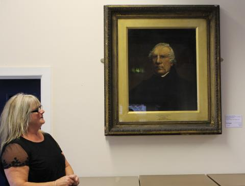 Middleton Township Chair Councillor June West looks up at the portrait of Samuel Bamford by Charles Potter