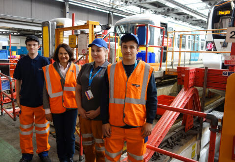 Apprentices (from left) Connor Philpot, Rosie-Jayne Wile and William Webster with MP Catherine West in Hornsey Depot