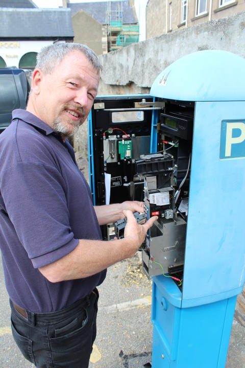 engineer Jim Williamson changing the mechanism in Elgin car park