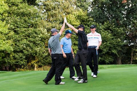 Rains fail to dampen spirits at charity golf day