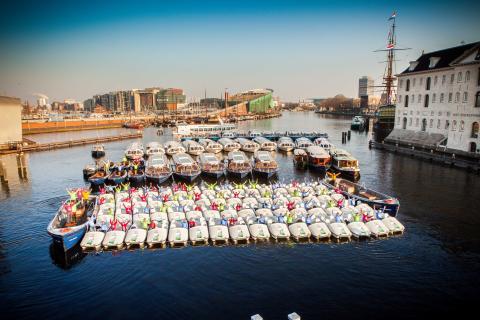 Canals flotta i Amsterdam