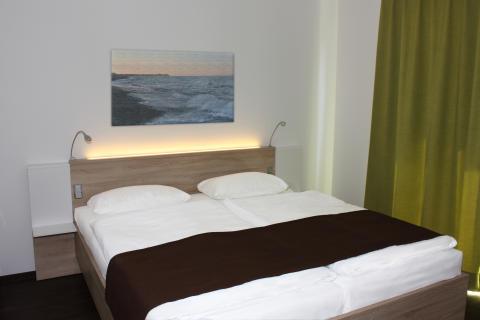 Premiumhaus_Schlafzimmer_Eltern (2)_credit_Ostsee_Resort_Damp
