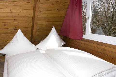 Nurdachhaus-Schlafen_credit_Ostsee_Resort_Damp