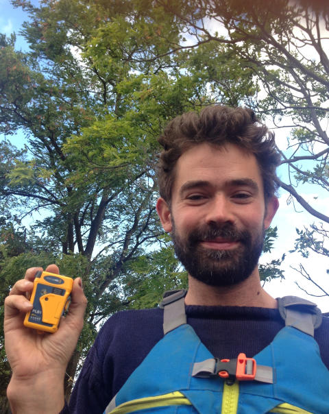Hi-res image - Ocean Signal - Adam Weymouth with the Ocean Signal rescueME PLB1 that he carried during his Alaska journey
