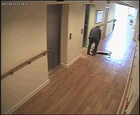 CCTV still showing victim after he was pushed out of a lift at the block of flats