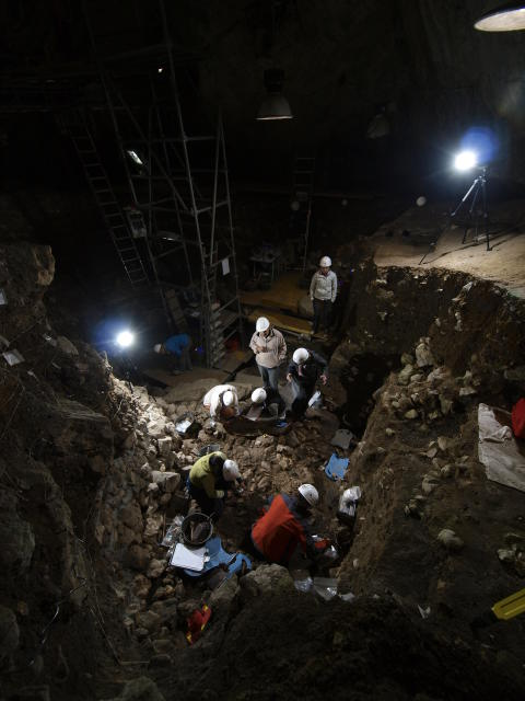 Excavation of Neolithic human remains at the Portalon cave.