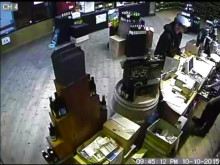 CCTV of the robbery at an off licence in Lambeth.