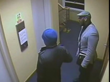 Suspect (r) standing with the victim - robbery, N12