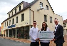 Eröffnung des neuen Geschäftshauses der Firma Henry Wendt bietet Anlass für großzügige Spende für Bärenherz