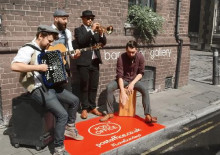 Street Performers in Edinburgh Celebrate Sundays with the Post Office