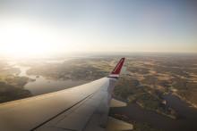 Norwegian tilbyr kunder CO2-kompensasjon og blir det aller første flyselskapet som signerer FN-program for klimatiltak