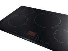 Uusi LCD-näytöllä varustettu Bosch-induktiokeittotaso opastaa keittiössä