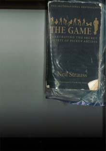 A copy of the book 'The Game' found at Ojo's address