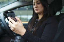 Only three in five drivers who use a handheld phone say causing an accident would make them kick the habit