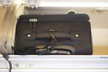 Handbagage ökar när flygbolagen tar betalt för incheckat