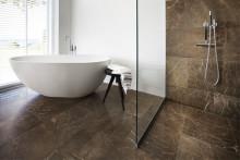 Nya generationens osynliga golvbrunn. Design för badrum.