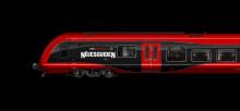Det röda Nöjeståget rullar mot Hotell Nöjesguiden med MTR Express