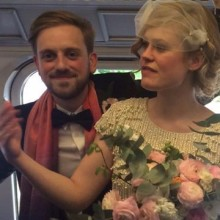 Happy couple take the train to wedding reception