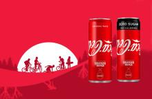 Kesän Coca-Cola -tölkeissä logo väärinpäin