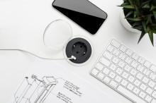 Nyhet! Eluttag och telefonladdare infällda i bordet – både smart och snyggt