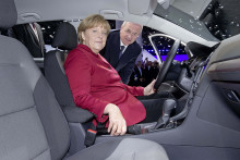 Germany's Federal Chancellor Merkel is guest of Volkswagen at the IAA