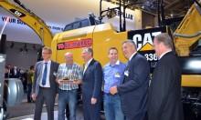 Den første Cat hybridgravemaskine kom til Skandinavien