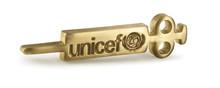 En vaccinationsspruta i mässing UNICEFs nya kampanjsymbol