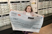 Eye cancer youngster accepts £160,000 charity donation from Vision Express