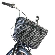 Reflekterande regnskydd till cykelkorgen