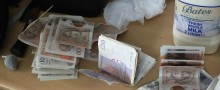 Man and woman arrested and drugs, cash and stun gun seized following warrant in Norris Green