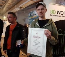 Tidigare  måleristuderande förärats medalj för sin yrkesskicklighet