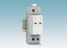 Narrow surge protective device for DC current sources