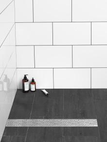 Nytänkande design i duschen med traditionell säkerhet
