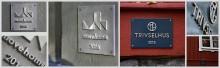Märkningen med gjutna brons- och aluminiumskyltar signalerar vad det handlar om för Trivselhus och MoveHome