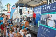 25 Jahre Kinderfest – EPPLI übernahm die spannende Kofferversteigerung