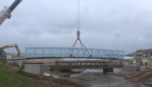 New bridge deck lifted into place