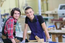 Ett utbyggt lärlingssystem främjar småföretagen och sänker trösklar