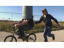 Stunt with teen on bike