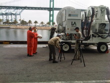Mårten and Oskar discuss filming tactics beside a Cavotec AMP Mobile unit at the Port of LA #Cavotecfilm #shorepower