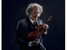 Geoffrey Rush som Einstein med sin fiol