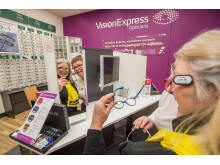 Judy Pride trying on glasses with Jane Lawley, the store manager at Bradley Stoke 'Vision Express at Tesco'.