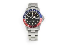 """Rolex armbåndsur af stål. Model Master GMT """"Gilt"""" (1966) Vurdering: 100.000-150.000 kr."""