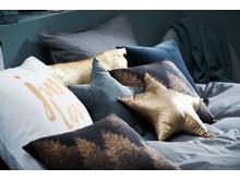Glittrig kudde NIDHUG (139 SEK), STJERNE (69,95), STALL (79,95 SEK)