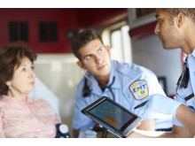 An EMT uses a HP ElitePad Rugged Tablet to check on a patient while in an ambulance.