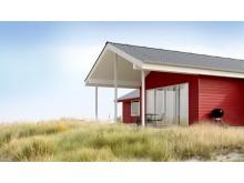 Röd fasad i fibercement som liknar trä